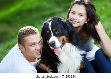 Portrait of a young couple with a dog