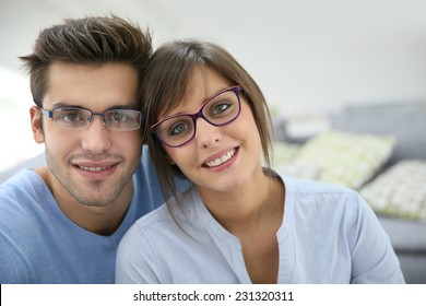 Portrait of young couple with eyeglasses on