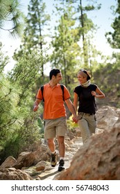 Portrait of a young couple of hikers smiling