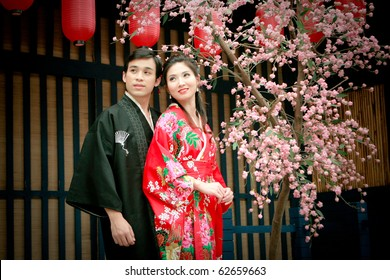 Portrait of young couple in japan dress looking to sky
