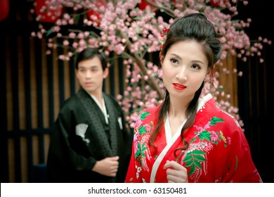 Portrait of young couple in japan dress looking for something