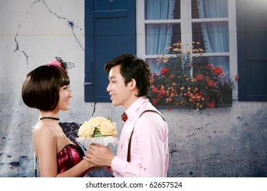 Portrait of young couple looking each other