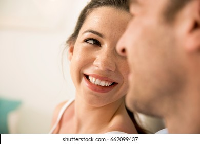 Portrait of a young couple looking to each other