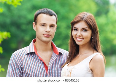portrait young couple love standing next background summer green park