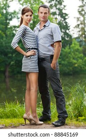 portrait young couple love woman man full-length background pond summer green park
