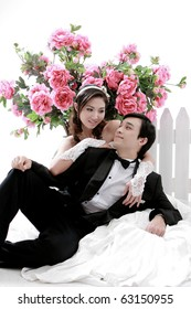 Portrait of young couple in lovely action with flower in background