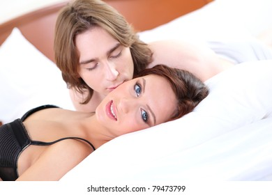 portrait of young couple of lovers in bed