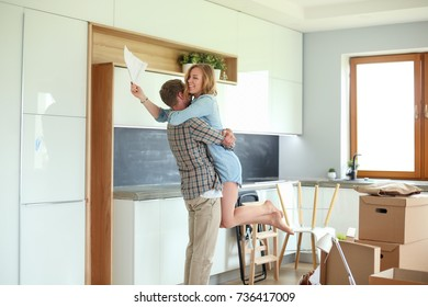 Portrait of young couple moving in new home. Young couple