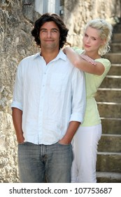 portrait of young couple on holiday abroad