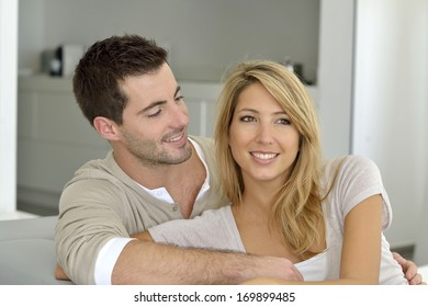 Portrait of young couple relaxing at home