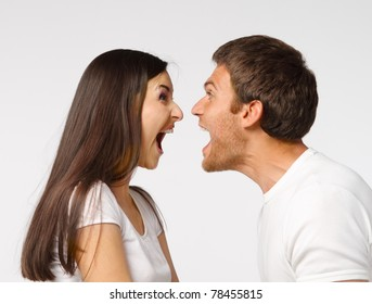 Portrait of a  young couple screaming to each other