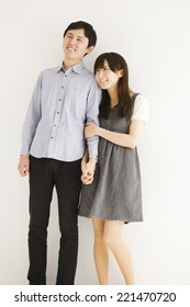 Portrait of young couple standing