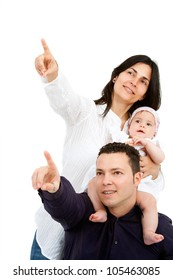 Portrait of young couple with their baby daughter pointing at copy space. Isolated on white background.