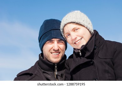 Portrait of young couple in winter against sky - Herten, Germany