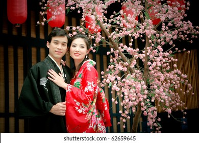 Portrait of young couple in yukata dress hugging each other