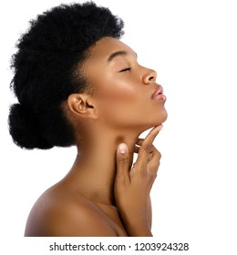 Portrait of young and cute african woman on white background