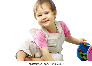 portrait of young cute child with a toy on a white background isolated