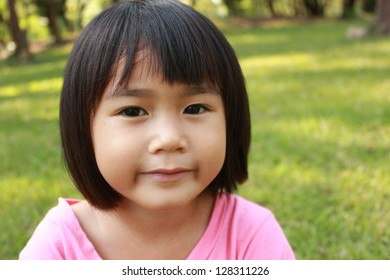 Portrait of young cute girl in the park