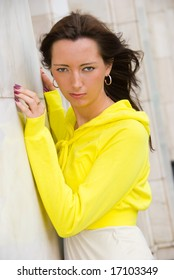 Portrait of a young cute woman dressed in yellow