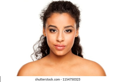 portrait of a young dark-skinned woman on a white background
