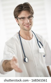 portrait of a young doctor welcoming