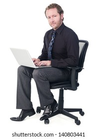 Portrait of a young doctor working on a laptop over white background