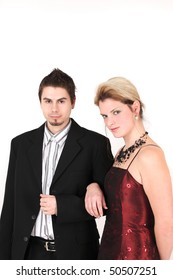 Portrait of young elegant couple with arms linked, studio shot