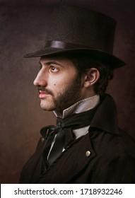 Portrait of young elegant gentleman in top hat.