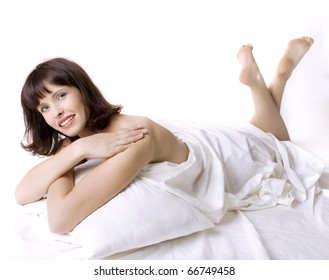 portrait of young elegant woman in bed