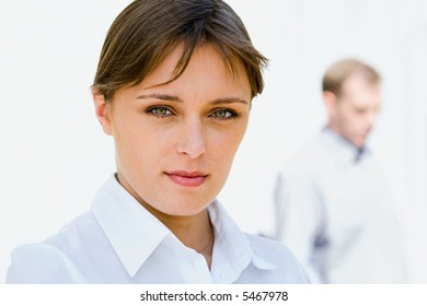 Portrait of young elegant woman on the white background of business man