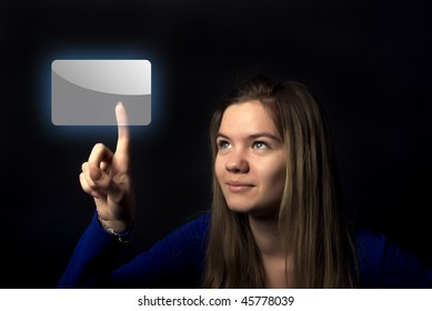 Portrait of a young emotional woman touching digital button