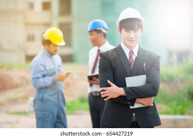 Portrait of young engineer in building construction site