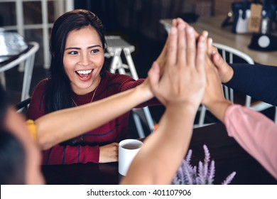 portrait of young enthusiastic team giving high five