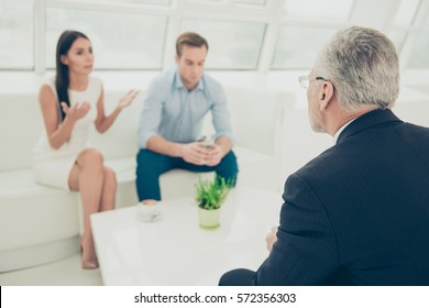 Portrait of young family with problems at a reception of psychologist.