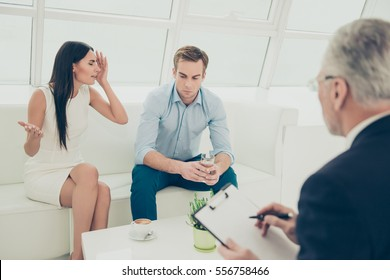 Portrait of young family quarreling at a reception of psychologist