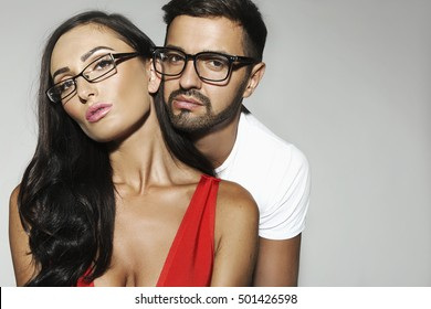 Portrait of young fashion man and woman with eyeglasses in fashion beautiful style