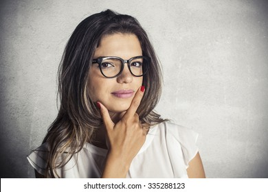 Portrait of young fashionable brunette woman with eyeglasses