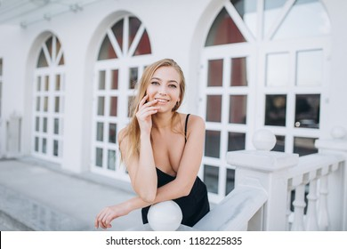 Portrait of a young fashionable glamourous gorgeous caucasian girl outdoors posing in a street
