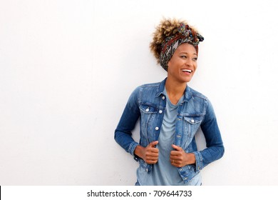 Portrait of young fashionable woman looking away on white background