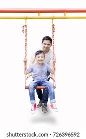 Portrait of a young father and his son playing with a swing, isolated on white background