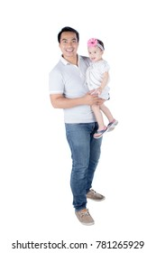Portrait of young father smiling at the camera while holding his daughter, isolated on white background