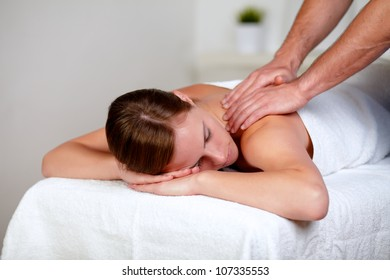 Portrait of a young fatigue woman lying on a stretcher at spa indoor