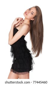Portrait of young female in black cocktail dress having thrown back her head isolated on white background