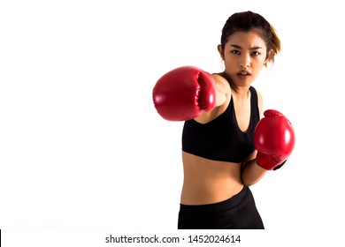 Portrait of a young female boxer punching on white isolated background with copy space. Young Asian woman doing boxing exercise with serious look.