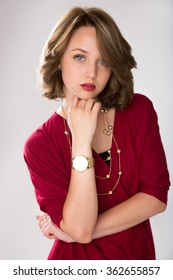 Portrait of a young female dark blond posing in a red casual outfit.