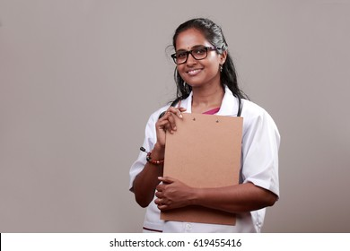 Portrait of a young female Doctor of Indian origin