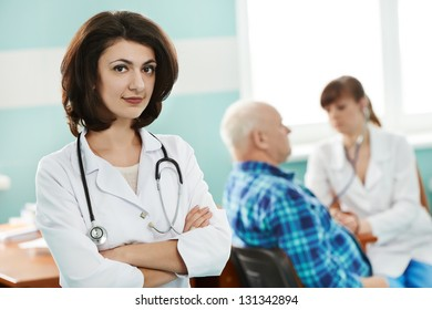 Portrait of young female doctor in medic uniform with stethoscope in hospital clinic