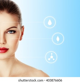 Portrait of young female with healthy skin over blue background with symbols of face moistening, rejuvenation and renew. Facial care concept.