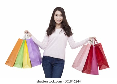 Portrait of young female holding shopping bags