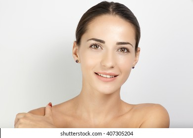 Portrait young female model with clear face and sking opposite white background